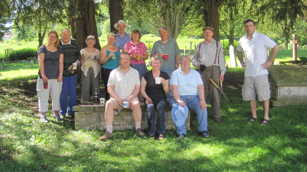 Team from the congregation taking a break in the churchyard