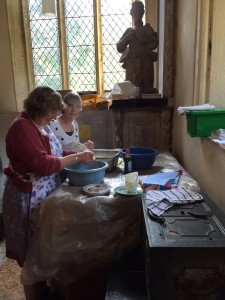 Washing up in the current vestry in the north aisle alongside to the memorial to Jane Cotton